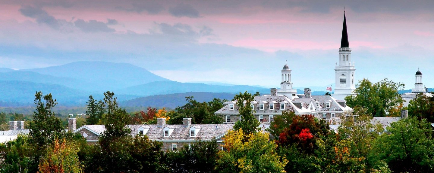 Panoramic view of Middlebury College sunset, with pink glow over the Green Mountains.