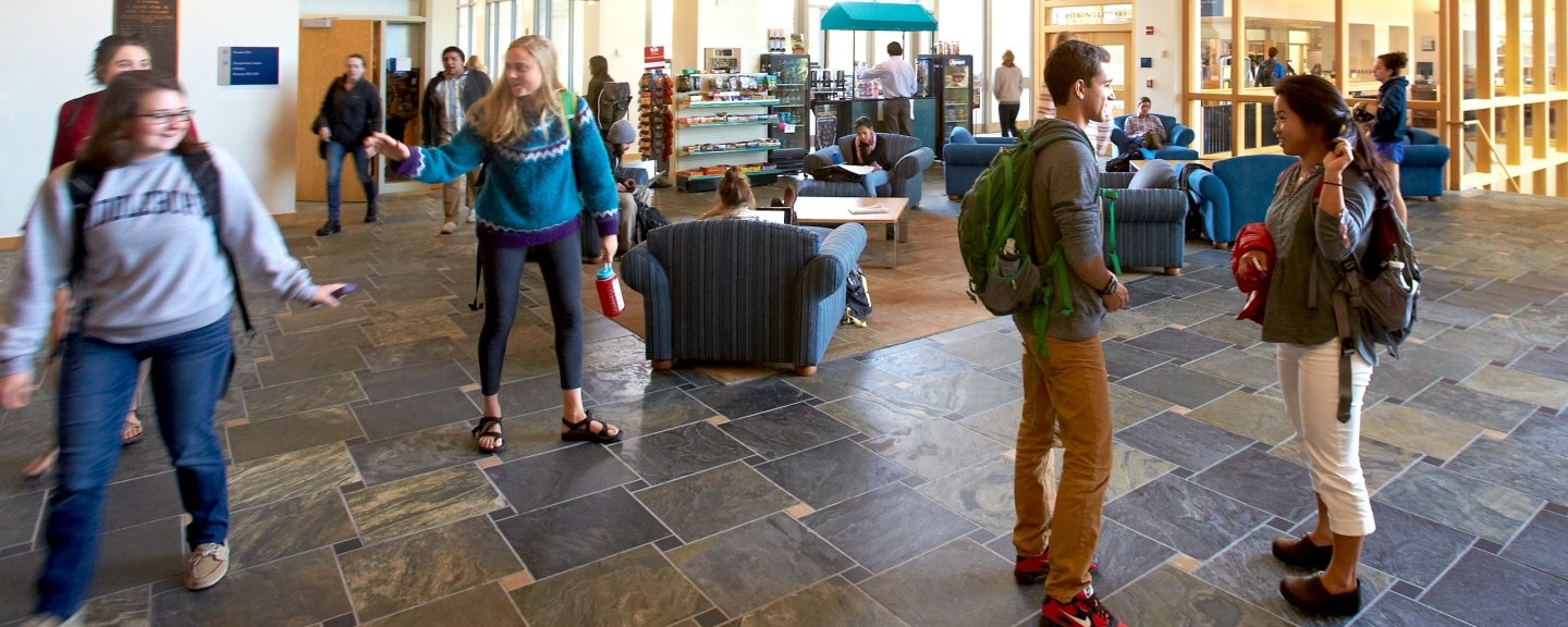 Students take a break from classes in Middlebury's McCardell Bicentennial Hall.