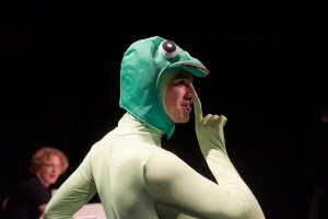 A student in a frog's costume