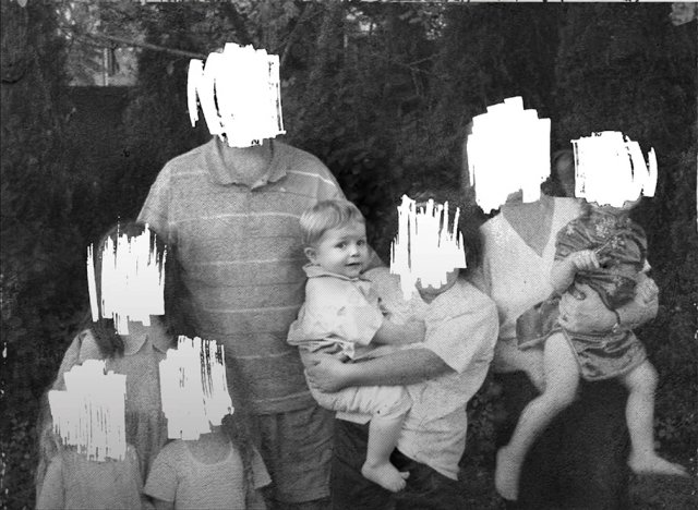 a black and white family portrait with all the faces scratched out except that of a little boy