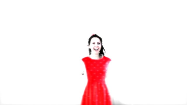a blurry picture of a young woman in a red dress
