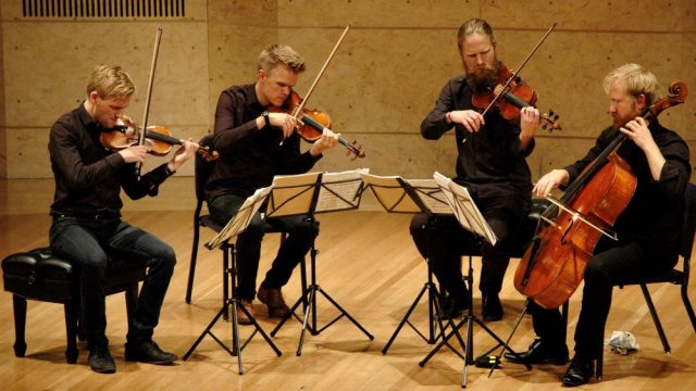 Danish Quartet performing stringed instruments on Robison Hall stage