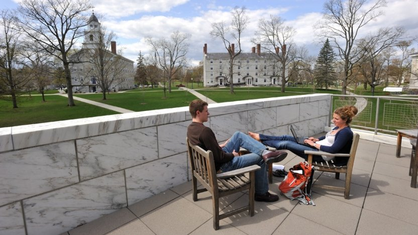 Students relaxing on the patio outside Middlebury's Davis Library.