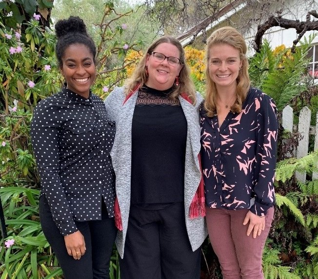 Professor Paige Butler with two students on MIIS campus