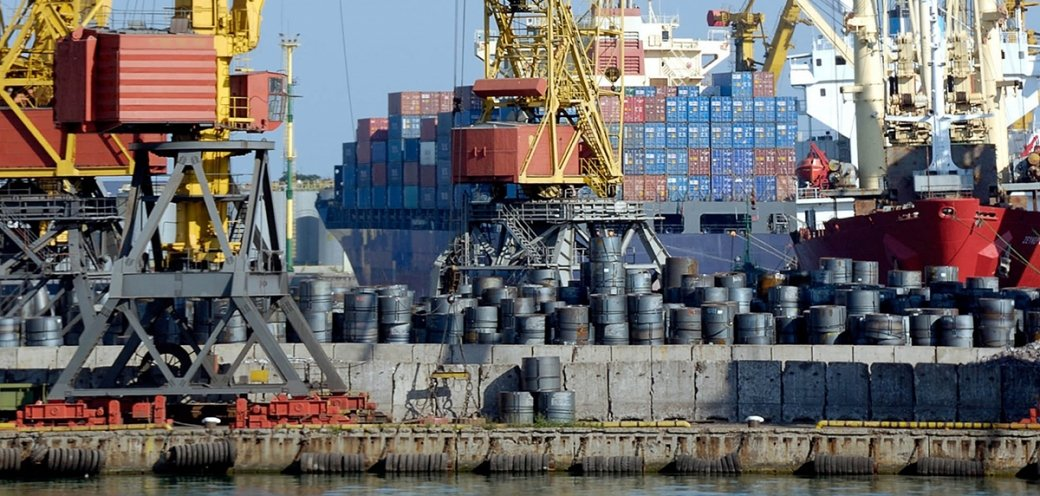 Photo of the Port of Los Angeles with container ships and barrels stacked high