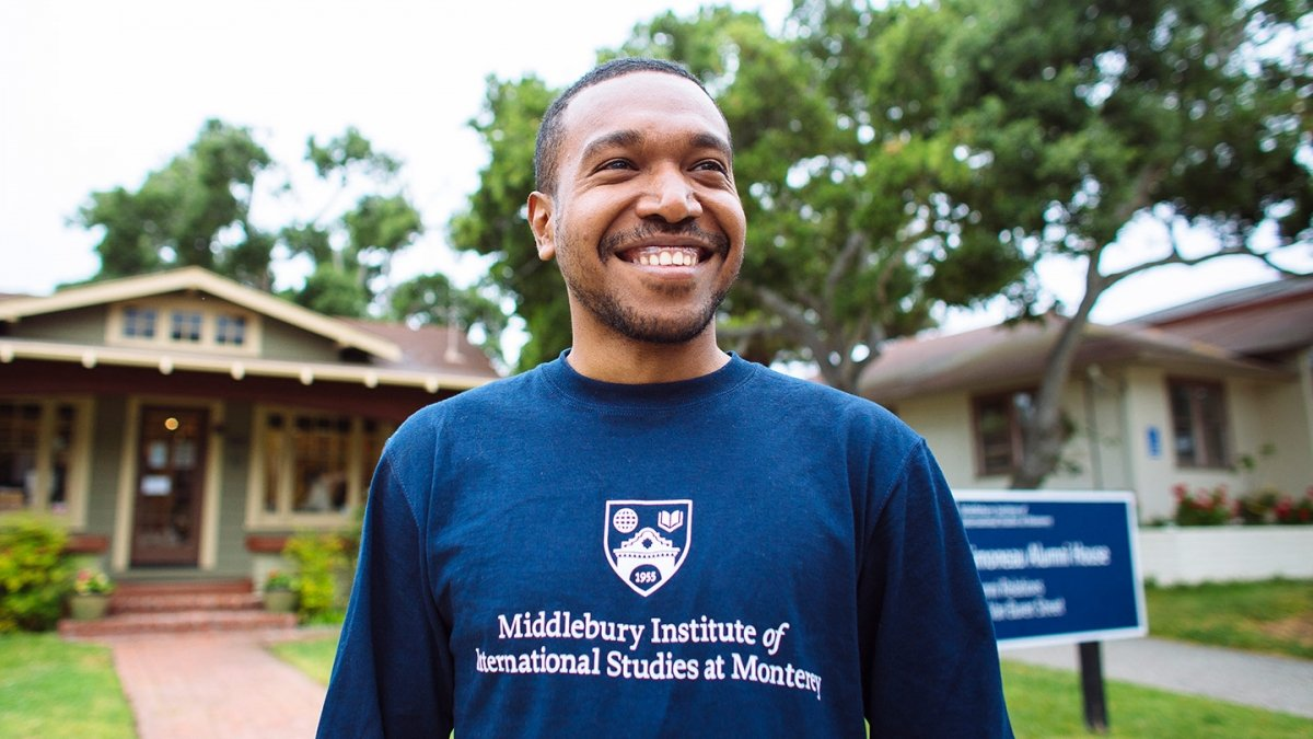 Profile photo of a smiling student outside of the Student Services building.
