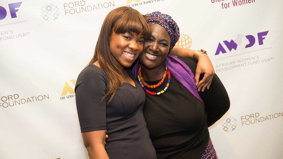 MIIS alumna, Maame Afon, hugging a colleague at the Africa Women's Development Forum