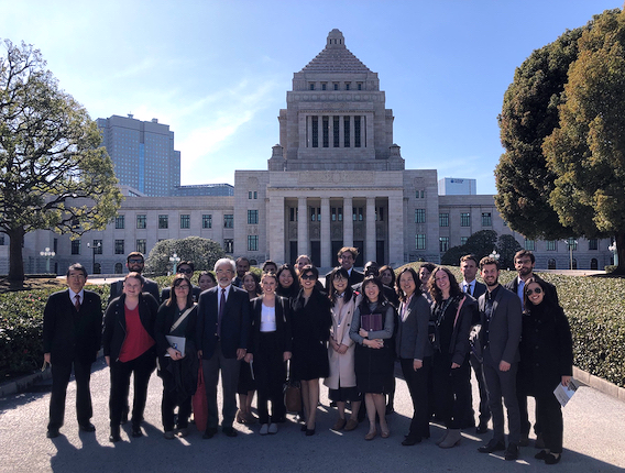 Group photo in front of a government building
