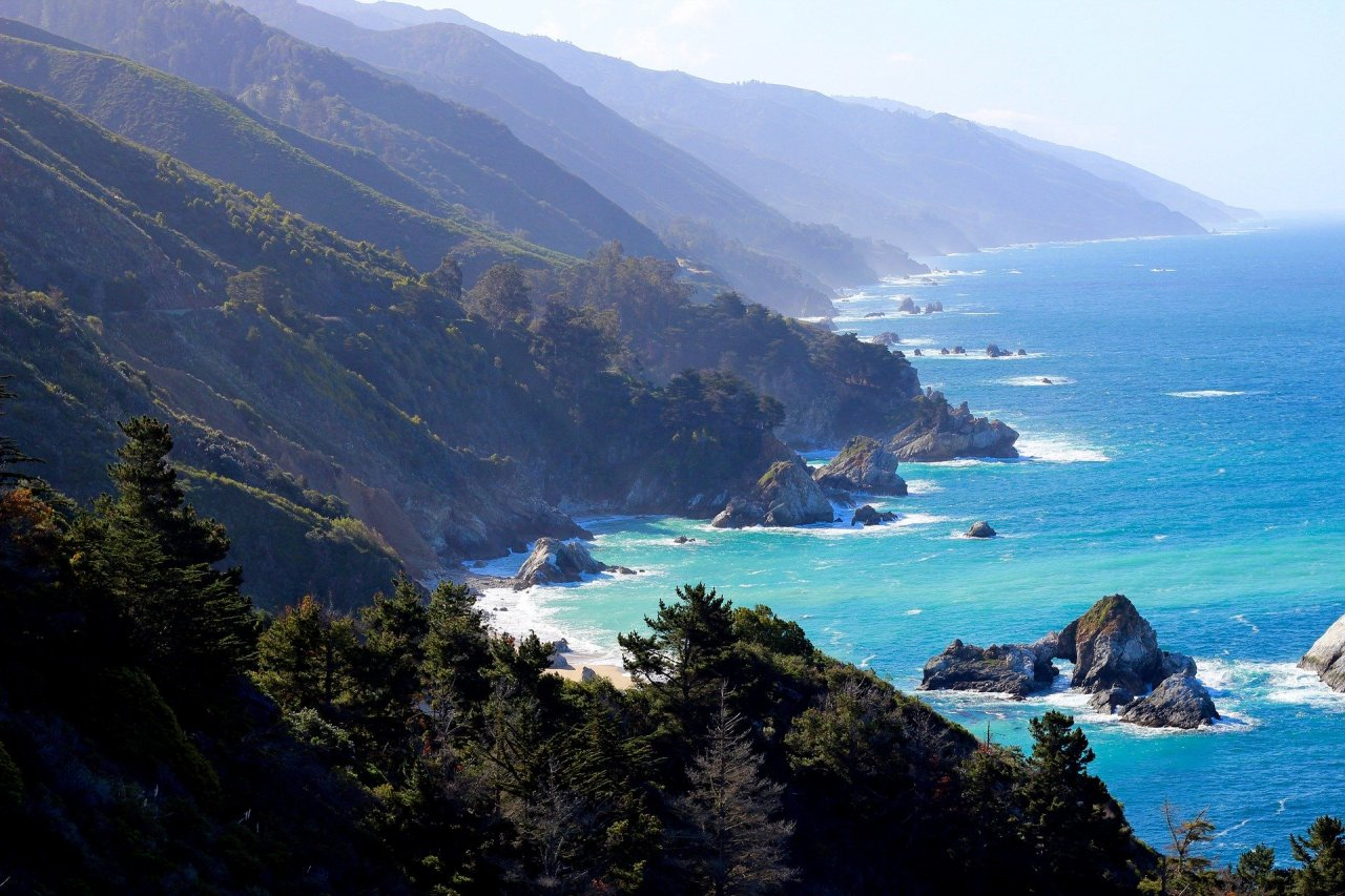 dramatic coastline of Big Sur, California.  Coastal mountains meeting turquoise blue ocean.
