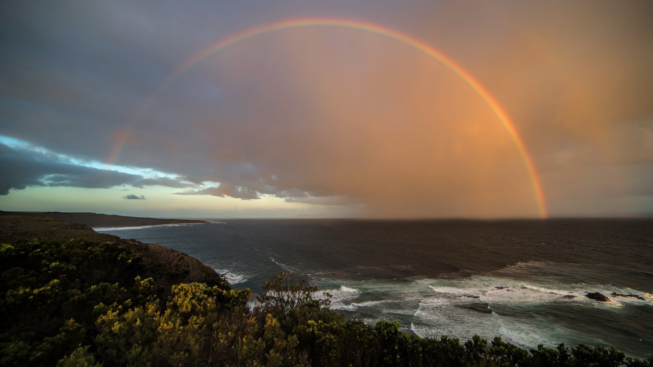 Rainbow over cliffs and ocean