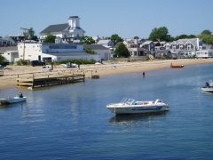 Cape Cod landscape showing shoreline, houses, boats
