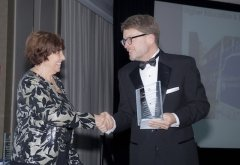 Mary Ann Leffel with Jeff Dayton Johnson and Award