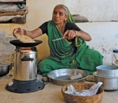Woman using a clean cook stove