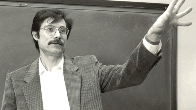 A photo from the archives of Carl Fehlandt teaching one of his classes.