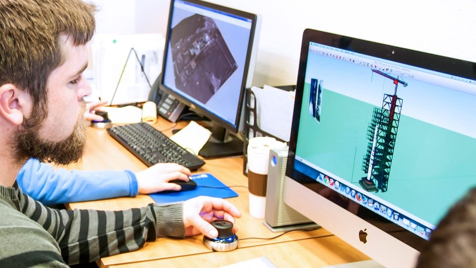 Student working at a computer doing research for one of the Institute's internationally recognized centers on campus.