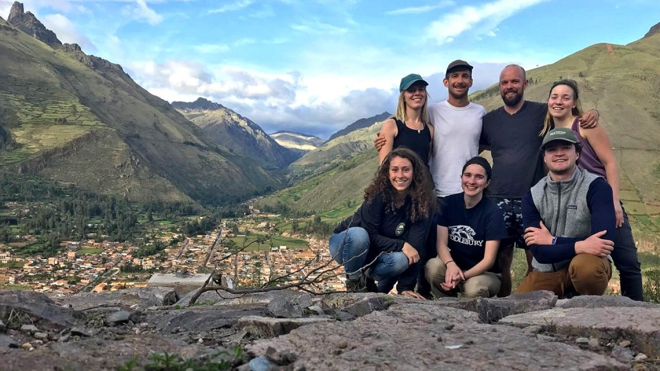 A group of students pose together in the mountains of Peru.