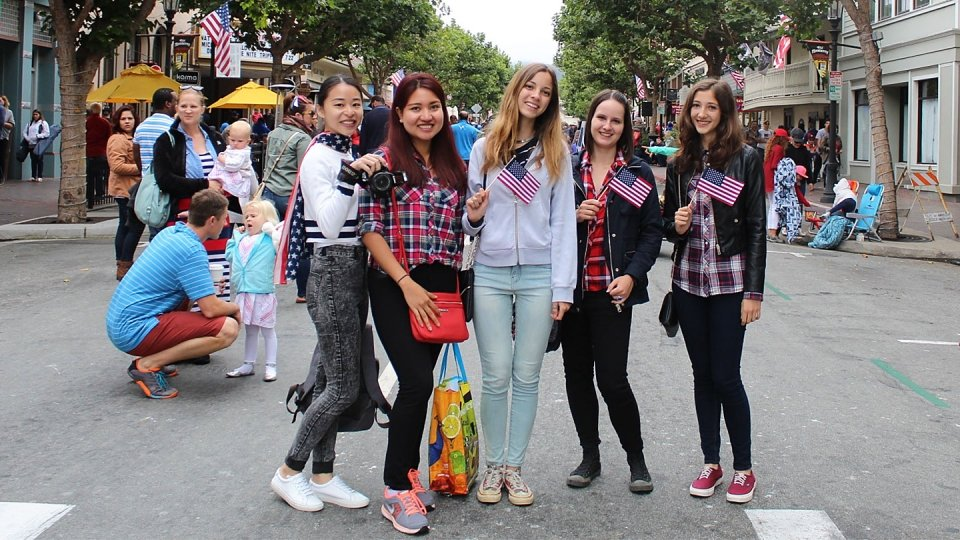 International students get a taste of American life at an outdoor market in Monterey.