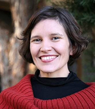 Image of Lacey Raak, young woman with big smile, brown hair, and wearing black turtleneck with red sweater.  Hosted by Center for the Blue Economy, part of Middlebury Institute of International Studies Hayward Sustainability Speaker Series.