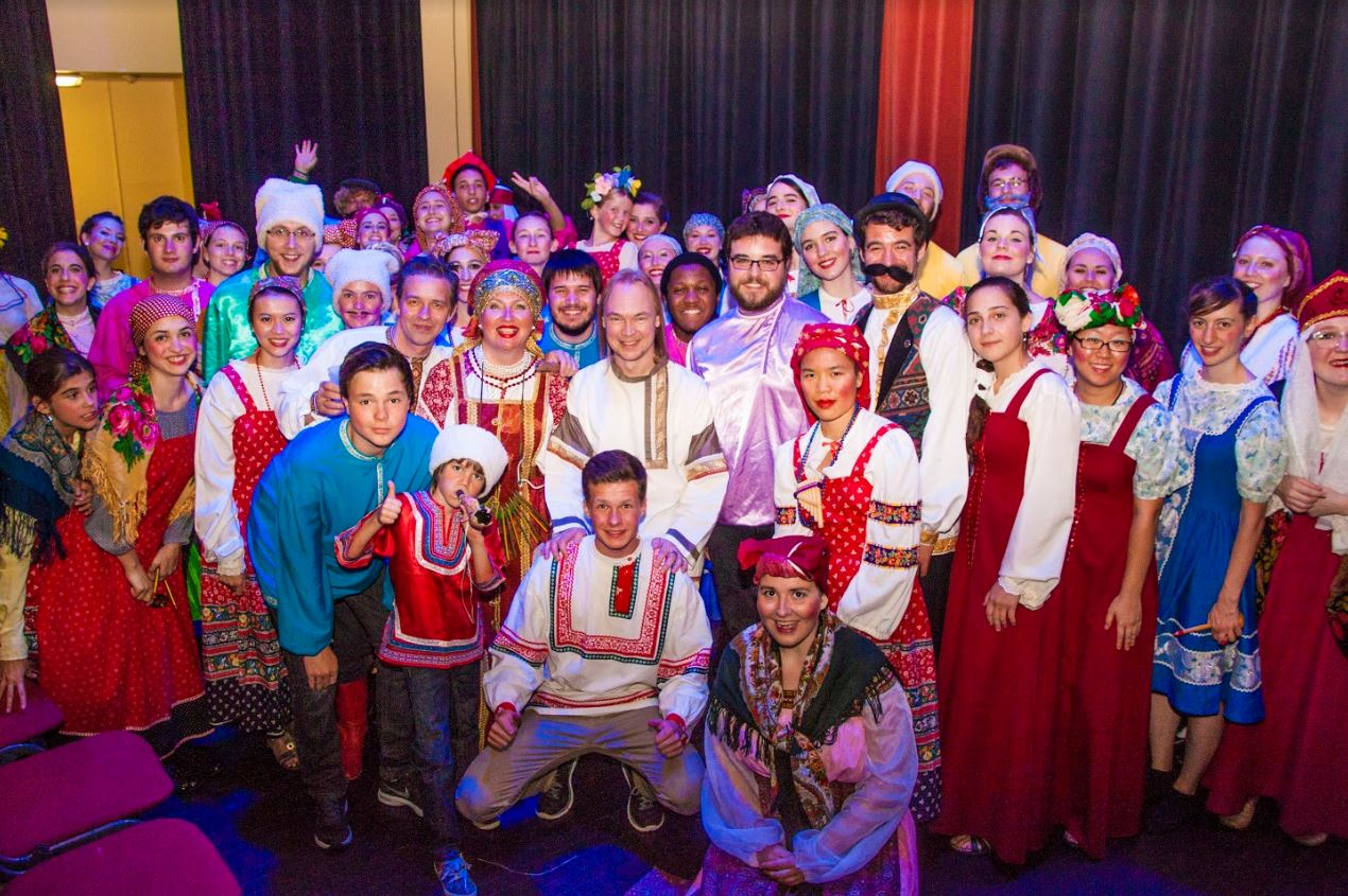 A group of students pose with their colorful Russian outfits.