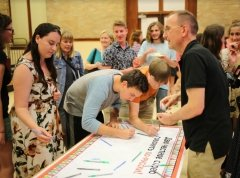 Students sign the language pledge with Program Director.