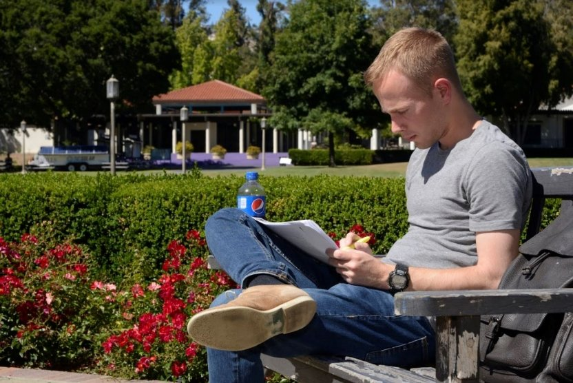 A student studies Italian in a beautiful setting.