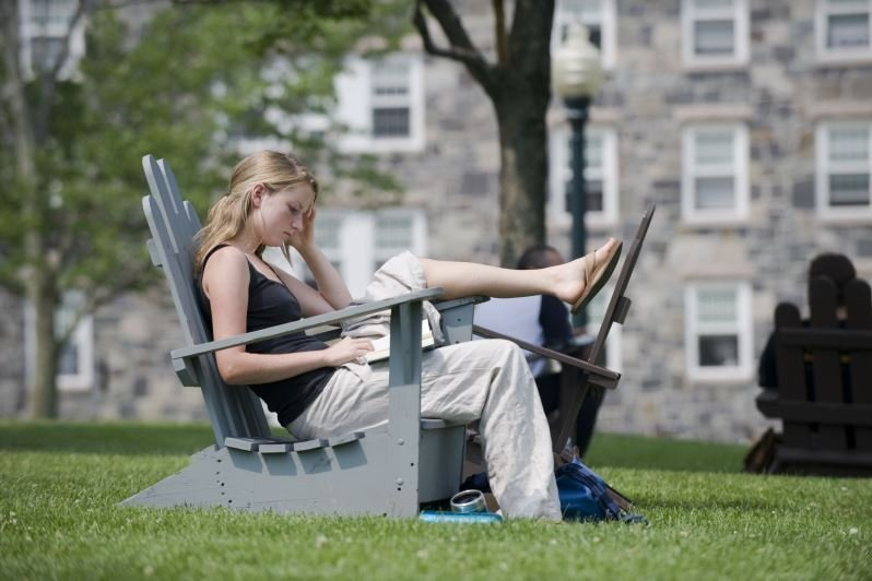 Girl is studing on the Middlebury Campus.