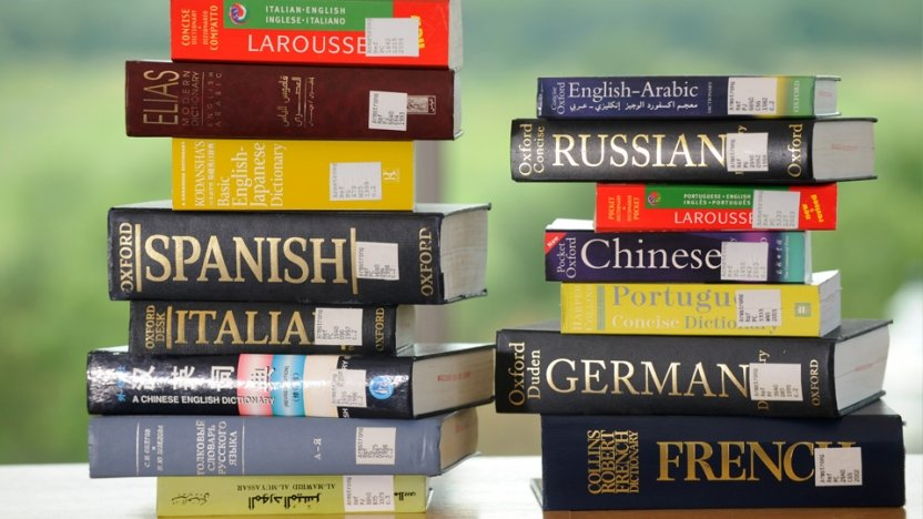 Stack of books in different languages.