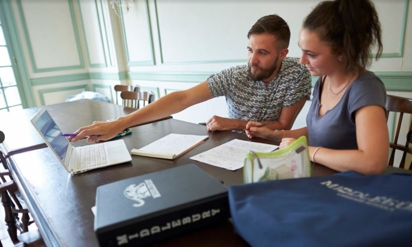Two students study at Middlebury.