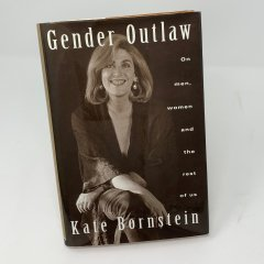 Cover of Gender Outlaw by Kate Bornstein. The cover features Bornstein seated and smiling.