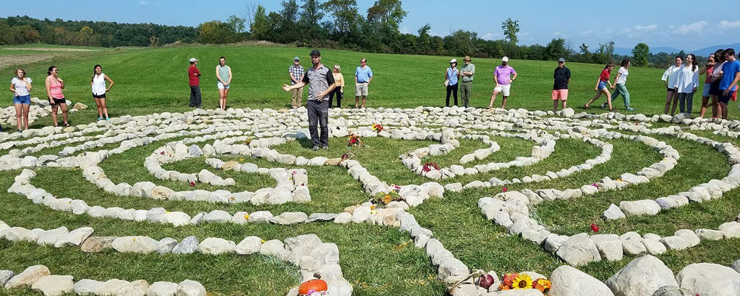 students celebrate completing the labyrinth at the garden.