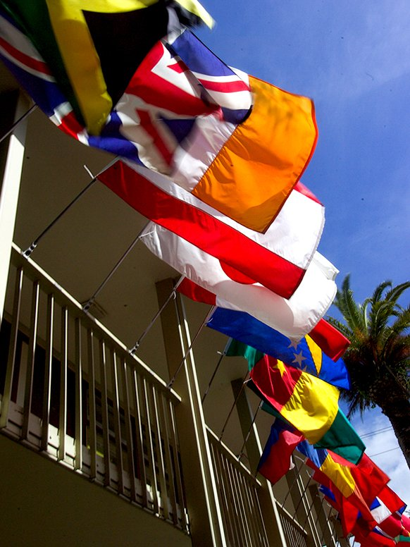 A cropped photograph of the many country flags flown on the buildings around the Middlebury Institute campus in Monterey, California.
