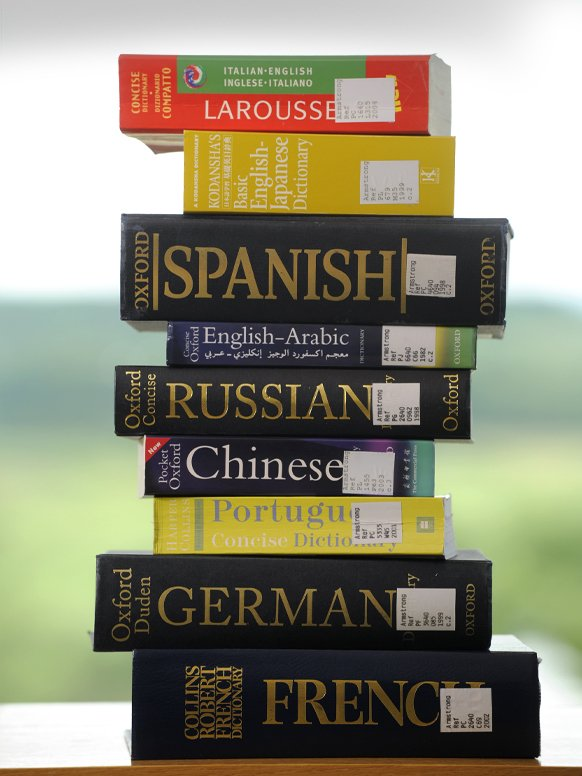 A stack of language dictionaries.
