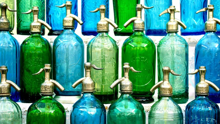 Green, teal, and blue bottles lined up.