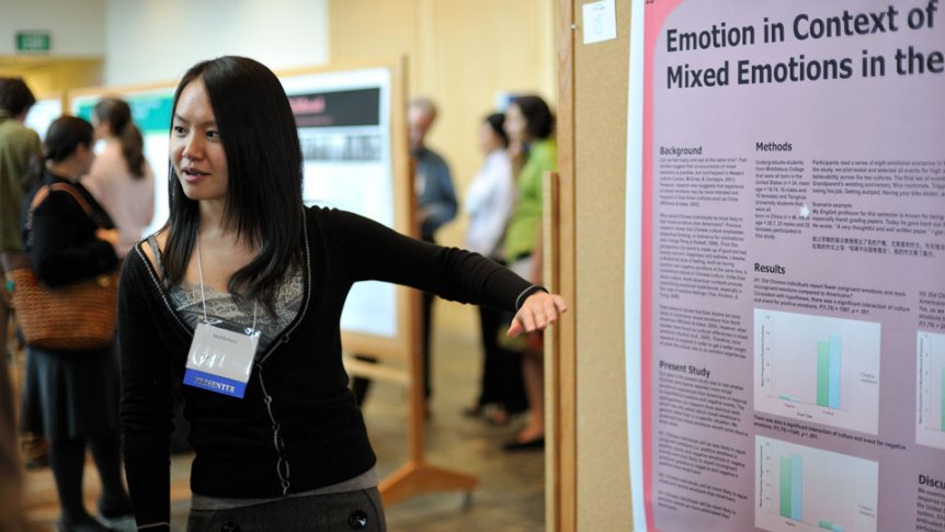 A student presents her research projects using a poster presentation.