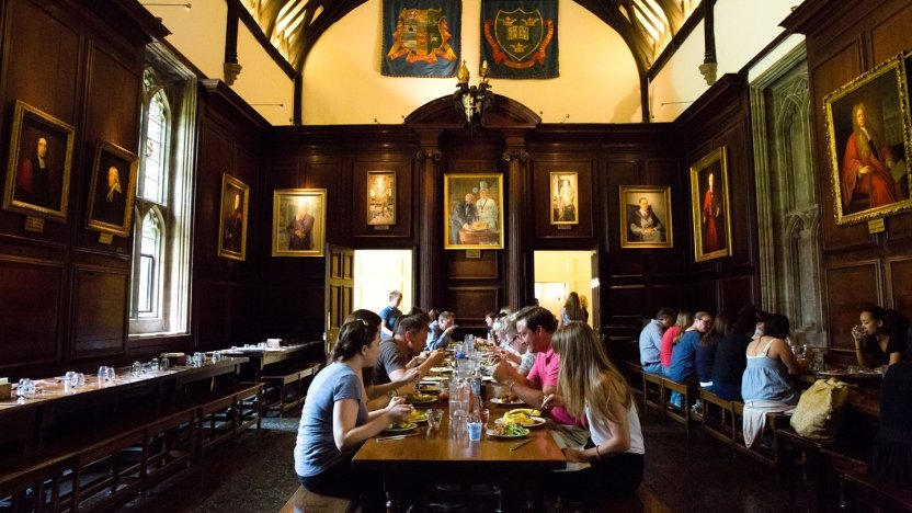 Students eating in dining hall on Oxford campus.