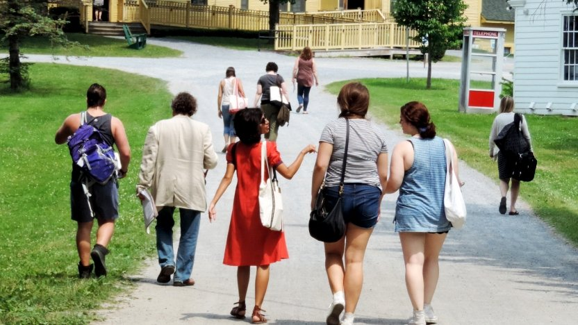 Bread Loaf student Himali Singh Soin and others walk from the Inn to the Barn for afternoon classes.