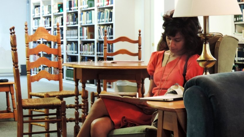 Bread Loaf student Himali Singh Soin gets some work done in the library before dinner.