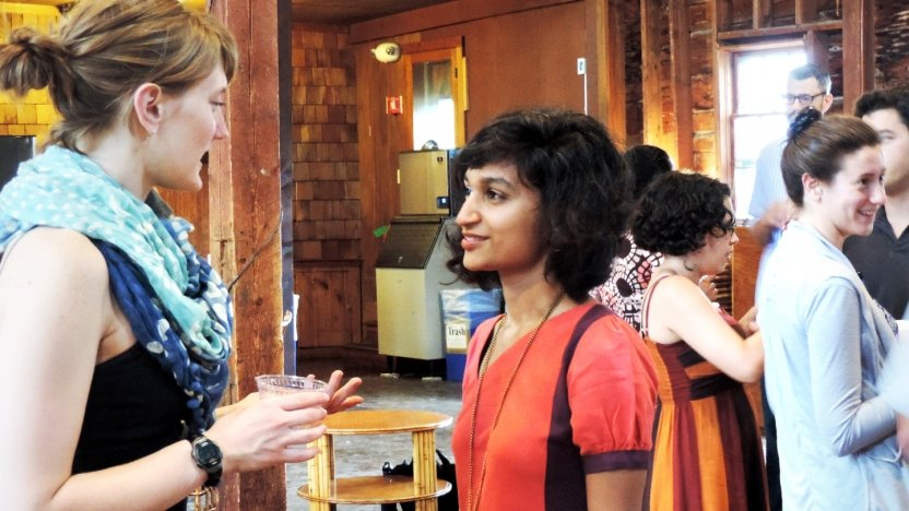 Bread Loaf student Himali Singh Soin chats with fellow classmates before an evening lecture in the Barn.