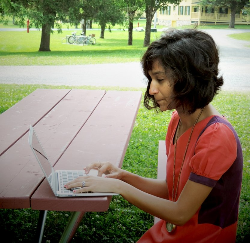 Bread Loaf student Himali Singh Soin works outside at one of the many picnic tables around campus.