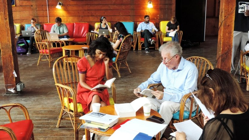 Bread Loaf student Himali Singh Soin discusses a project with her professor in the Barn.