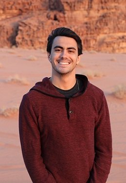 A student smiling in the desert