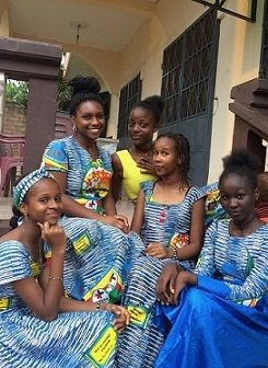 A student with her host sister and friends, wearing matching dresses