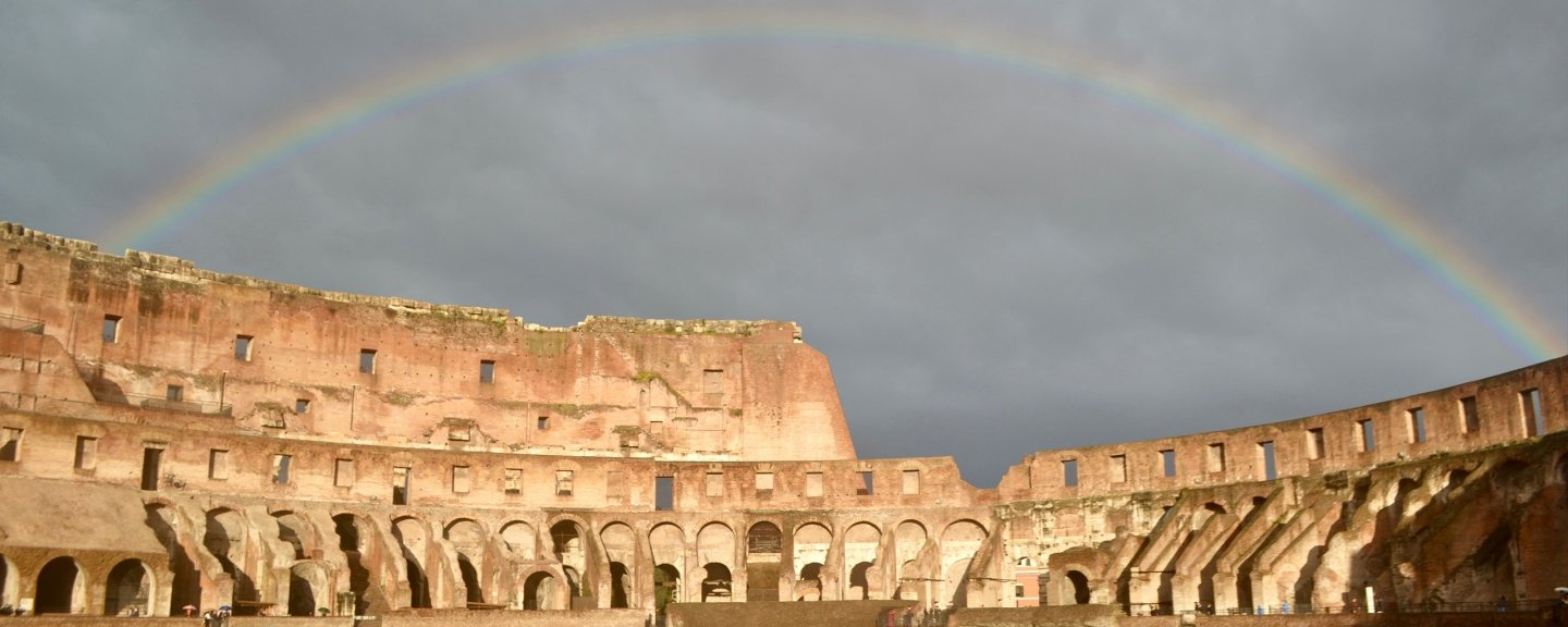 Image of Coluseum with rainbow in background
