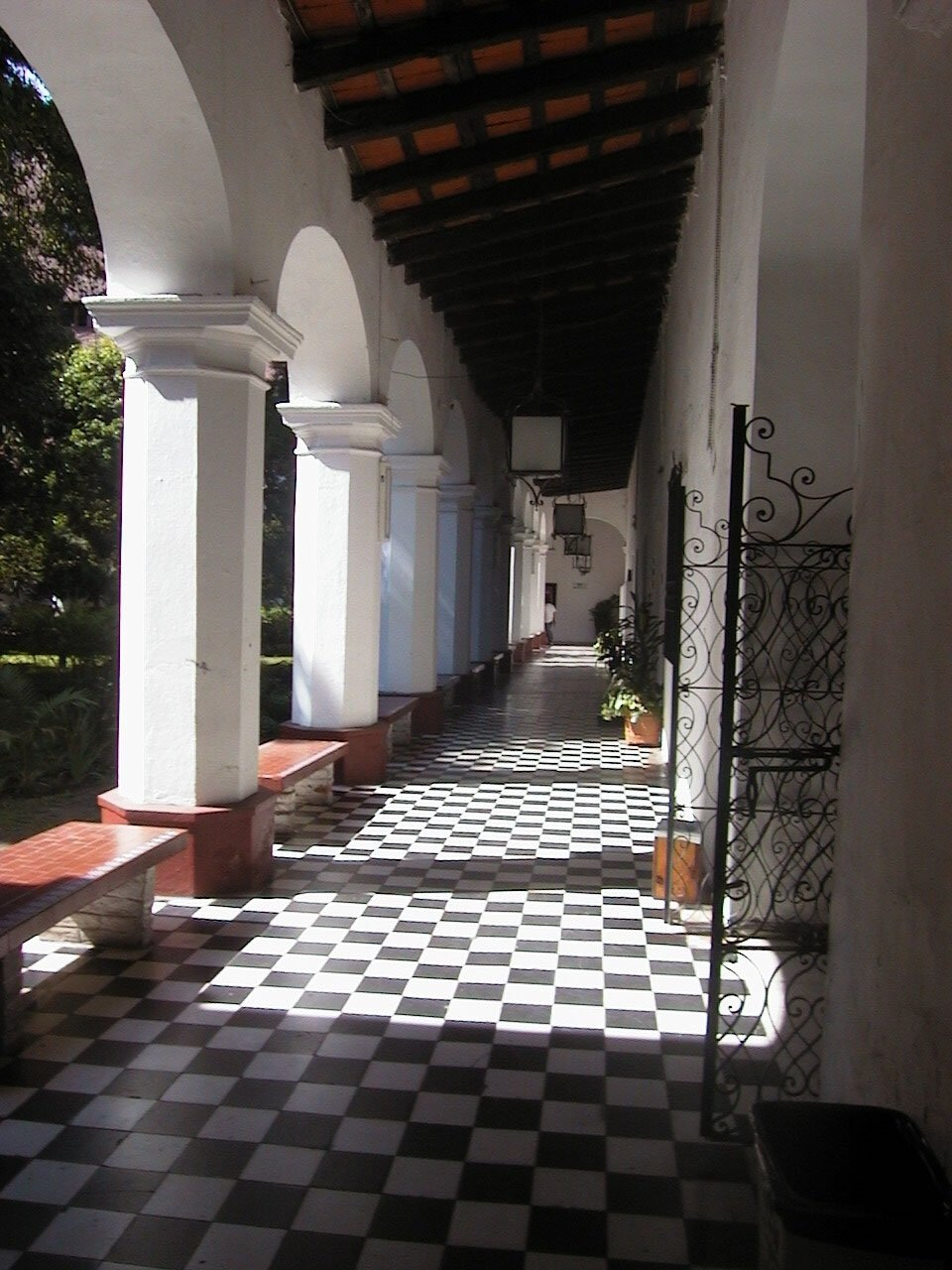 An outdoor corridor with archways