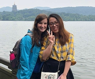 Two students posing by West Lake in Hangzhou, China.