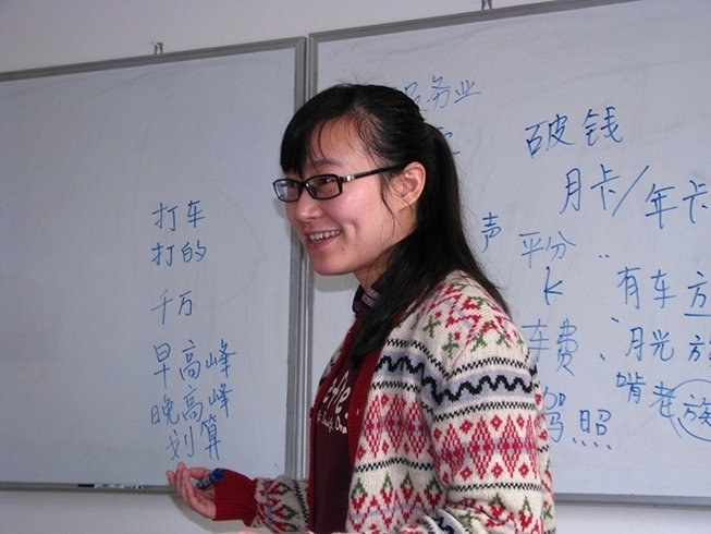 Photo of instructor at a white-board at the School in China.