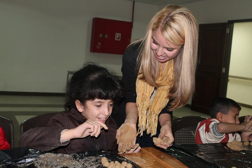 Photo of a student playing with a Jordanian child at the Academy for the Blind, in Amman.