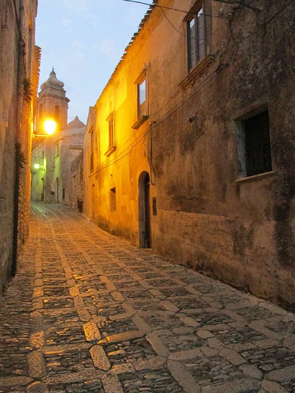 An empty street at dusk in Sicily.